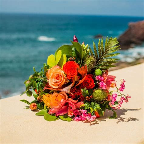 colourful tropical flowers fill  brides bouquet
