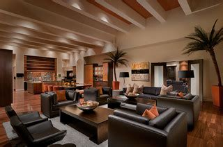 ownby design tropical family room phoenix  ownby
