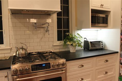 black honed granite Kitchen Modern with black countertop