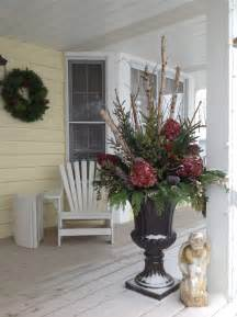 christmas entry urns on front porch using birch branches spruce tips cedar pine ice