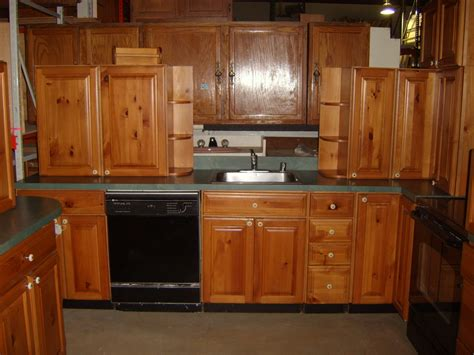 staring   light pine kitchen cabinets