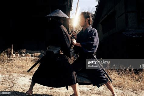 Two Samurai Warriors Fighting High-Res Stock Photo - Getty ...