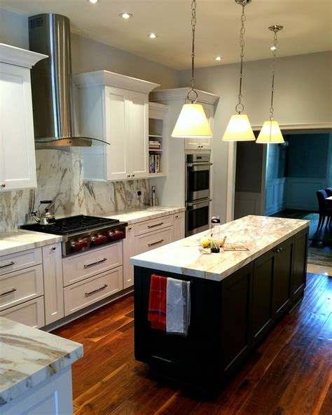 Wellborn Forest Chagne Cabinets by White Shaker Cabinets With A Gray Island From Wellborn