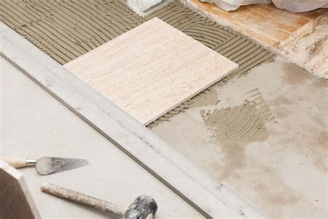 laying  ceramic tile floor