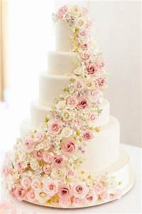 white wedding cake decorated with sugar flowers Deer