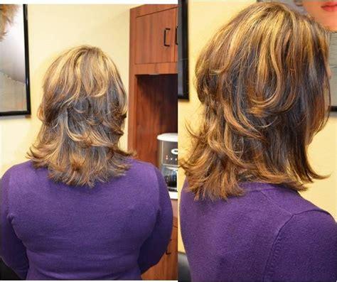 medium layered haircut  highlights  lowlights lots