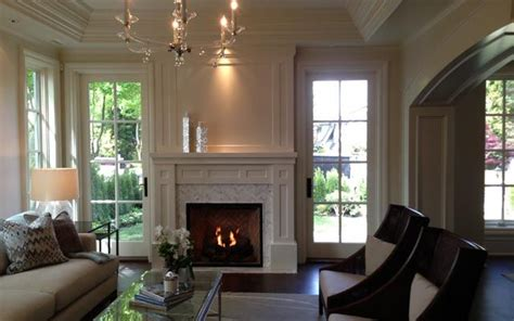 Living Room With Fireplace And Doors by I The Wooden Doors On Either Side Of The