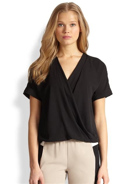 wrap front blouse lyst bcbgmaxazria natty wrap front blouse in black