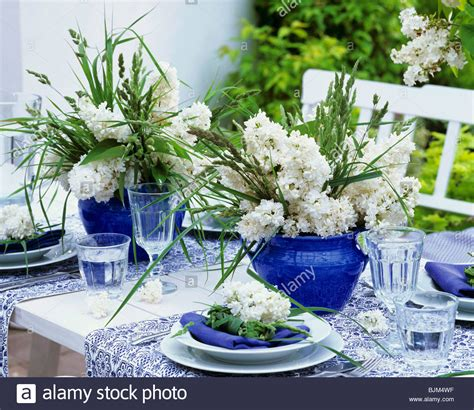 blue and white table centerpieces blue and white table decorations with lilac and grasses stock photo royalty free image
