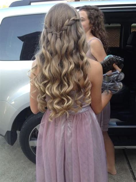 blonde curls with a waterfall braid connecting both sides