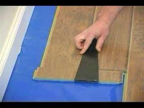 how to install laminate floor under door youtube