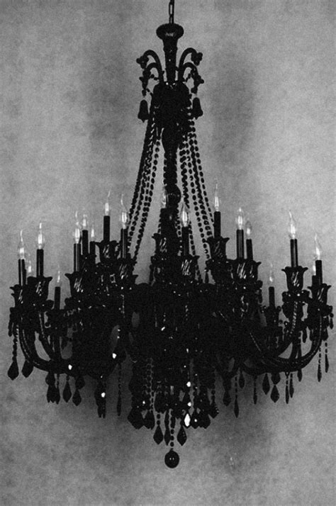 Picture Of a bold black chandelier with bulbs is a