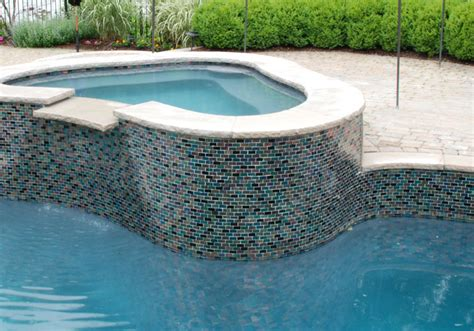 glass tiles at the waterline are the latest trend pool