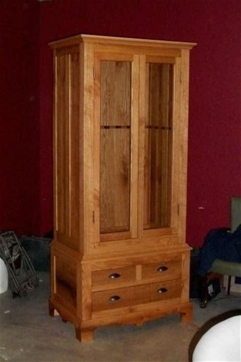 hand  custom oak gun cabinet   martens carpentry