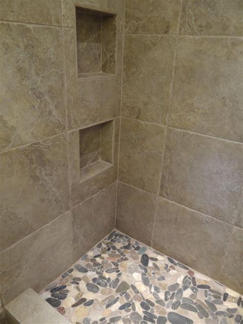 ceramic tile shower floor reversadermcream 18 quot x 18 quot porcelain tile on the walls with flat river rocks