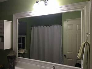 Bathroom mirror redo molding frame coastal bathrooms for Molding around mirror bathroom