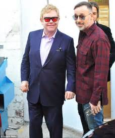Sir Elton John and husband David Furnish are the picture ...