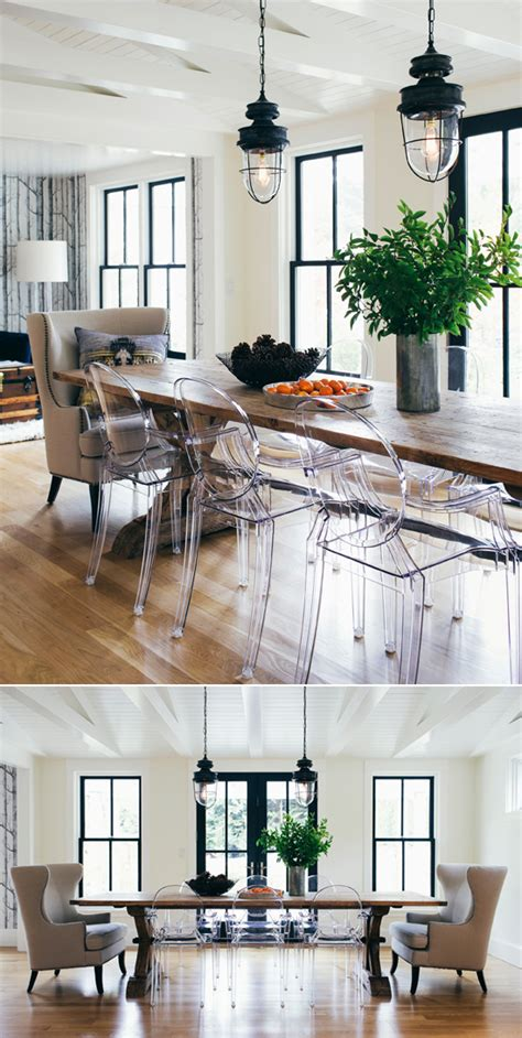 industrial lights and wood table and clear ghost chairs in
