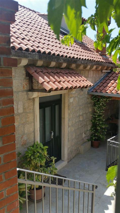 tile awning stone door frame house awnings outdoor awnings exterior doors