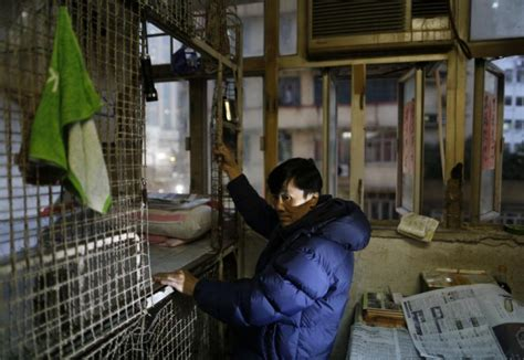 wealthy hong kong poorest   metal cages ny