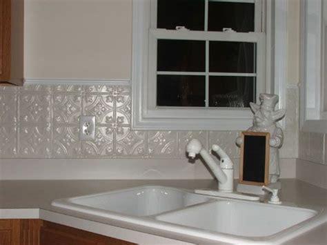 white tin backsplash adds visual interest