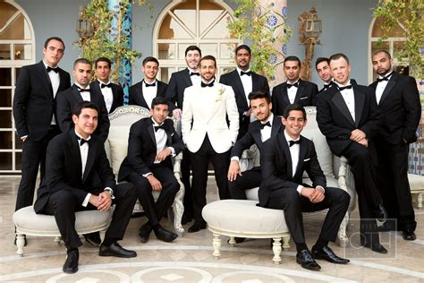 Black Tuxes With The Groom In A White Dinner Jacket. Love