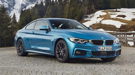 bmw  coupe review minor updates   positive