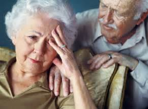 Elderly couple, woman holding her head with hand and man sitting with ...  Depression Isocarboxazid