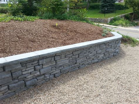 Unilock Wall Installation by Photos Landscaping