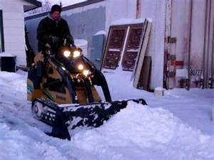 Mini Skidsteer Pushes Snow