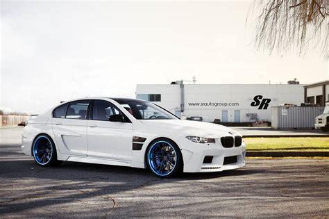 Blue and White Car Black Rims