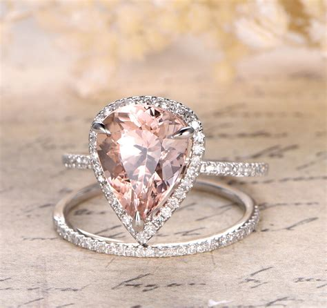 claw prongs xmm pear cut morganite halo diamonds trio