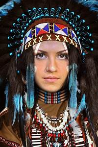 Native Indian face in hole. Native costume and war bonnet