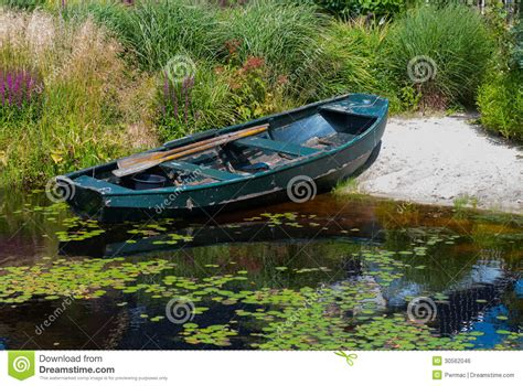 Japanese Rowboat by Rowboat In A Garden Pond Royalty Free Stock Image Image