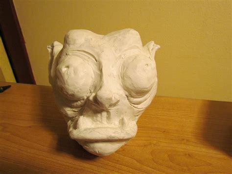clay goblin head  clay monster molding  cut