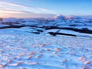 January A winter sunset bathes Tinto Hill and the valley ...