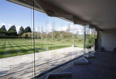 frameless glass bi fold car showroom doors search