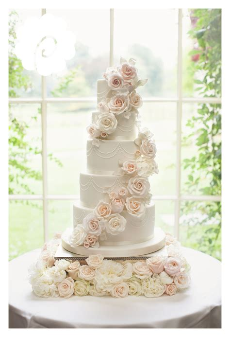 modern striking sugar rose cascade floral wedding cake