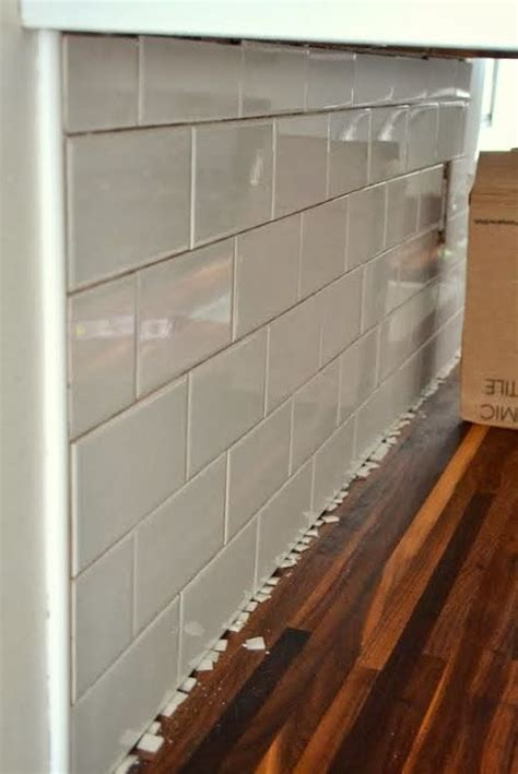 How To Put Up Tile Backsplash In Kitchen by How To Add A Tile Backsplash In The Kitchen Our Home