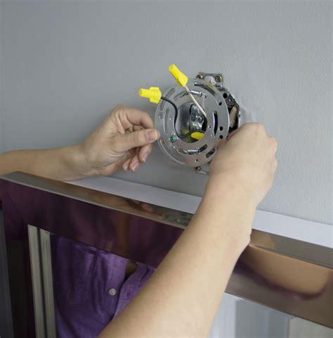 installing bathroom light fixture install a mirrored medicine cabinet and vanity light