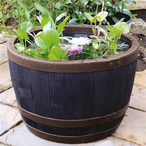 plastic barrel planter stewart garden blenheim wood effect plastic half barrel