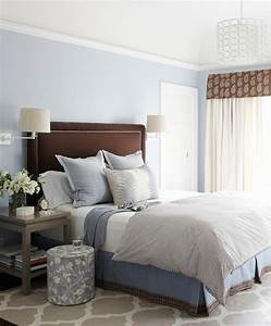 Brown and blue bedroom with gray nightstands