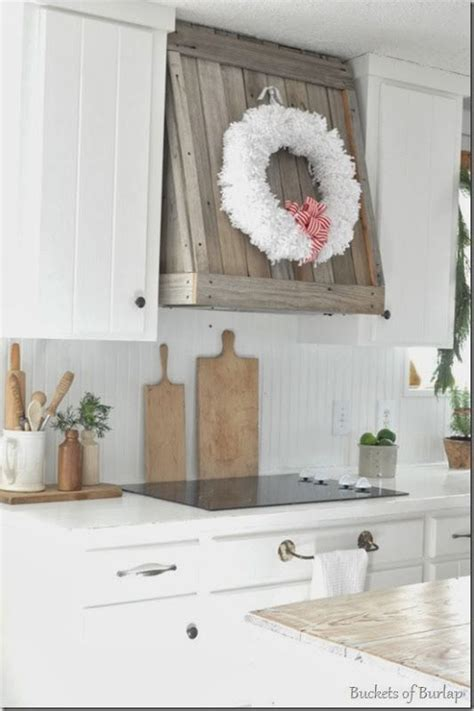 range hood christmas decorating ideas white pom pom wreath on weathered vent our farmhouse in 2019 home kitchen