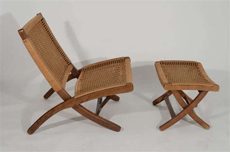 hans wegner style wood and woven rope chair and ottoman at