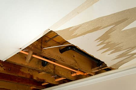water leaking out of ceiling fan water damage restoration fix walls ceilings diy