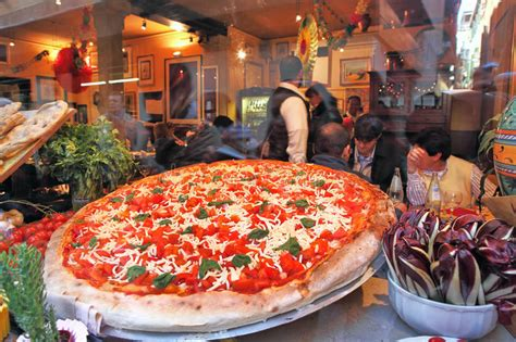 xl cuisine big pizza displayed in restaurant window in venice italy