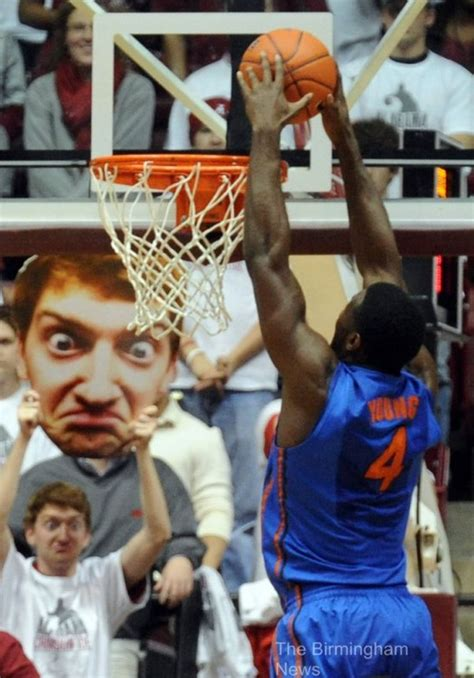 guy holding huge pic   face  basketball game