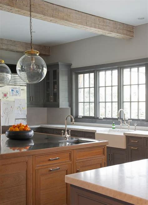 charcoal gray cabinets  brown red stained island transitional kitchen
