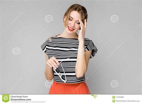 Attractive Young Blonde Shy Girl In Striped Blouse Smiling