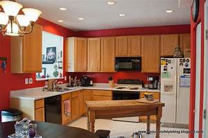 Interior classy black wooden kitchen island with grey for Kitchen colors with white cabinets with metal wall art red